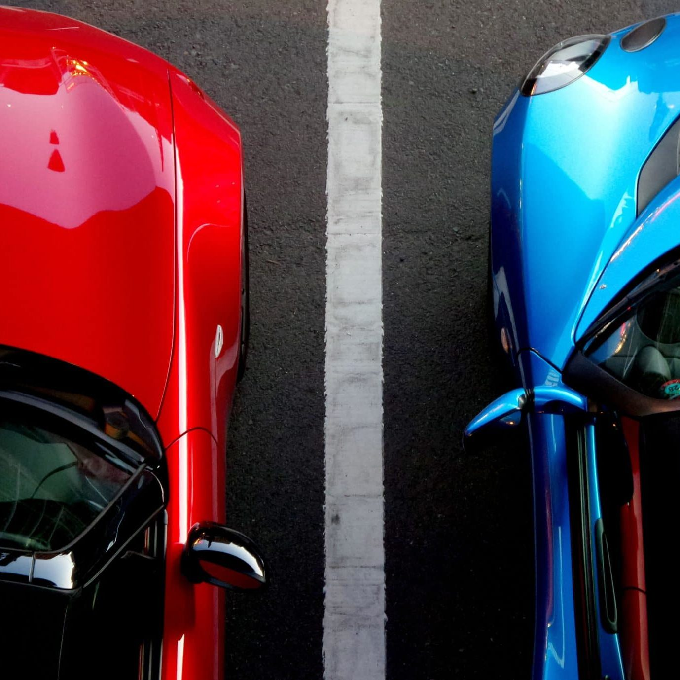 Red and blue cars for color matching on services page, Dent Busters in Tucson, Arizona